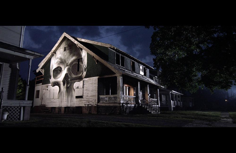 10-IAN-STRANGE-SUBURBAN-skull_house_home-stillframe-from-film-videoart-multi-channel-loop